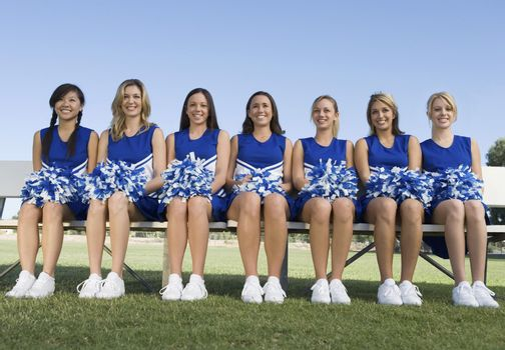 Cheerleading Squad Sitting on Bench