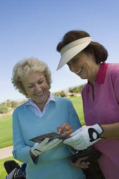 Golfers Filling in Scorecard