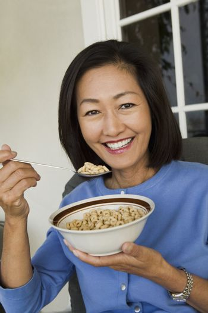 Woman Eating Breakfast Cereal