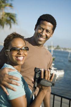 Couple with Video Camera at Marina