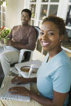 Woman Computing on Porch