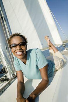 Woman Lying on Sailboat