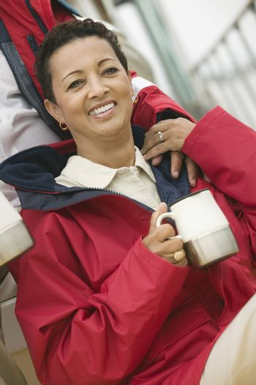 Woman with Coffee Mug on Boat