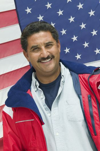 Man in Front of American Flag