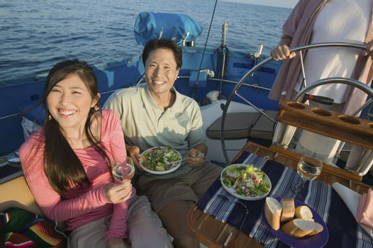 Couple Eating Salad on Sailboat