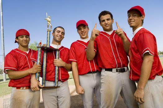 Teammates Holding Trophy