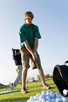 Young Men at Driving Range