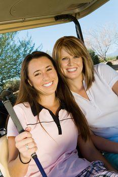 Golfing Friends Sitting in Golf Cart