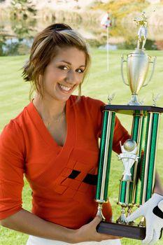 Golfer Holding Tournament Trophy