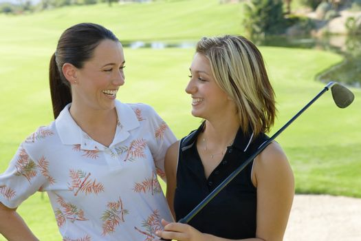 Friends Laughing on Golf Course