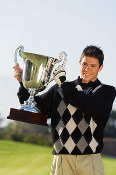 Golf Champion Holding Trophy