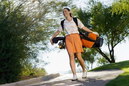 Golfer Walking Down Path to Next Tee