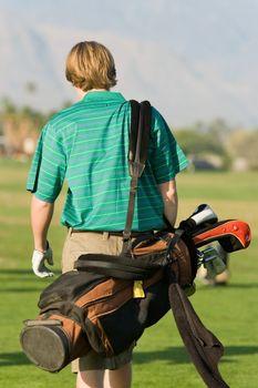 Golfer Walking Down Fairway Carrying Club Bag