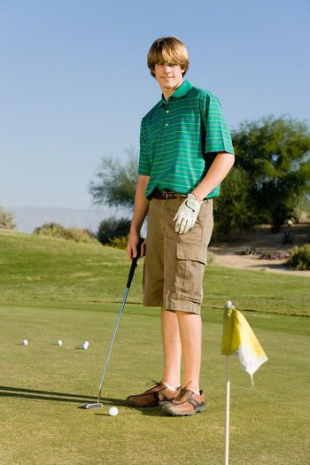 Golfer Putting on Practice Green