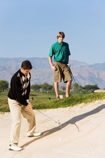 Golfer Preparing to Hit Out of Sand Trap