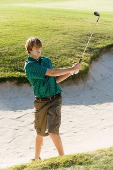 Golfer Standing in Sand Trap