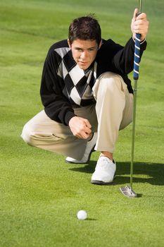 Golfer Lining Up Putt