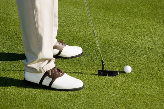 Golfer Preparing to Putt for Par