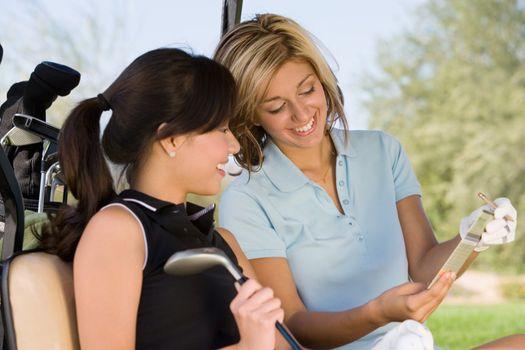 Golfers Looking at Scorecard