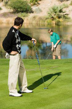 Golfer Watching Friend Make Shot