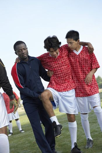 Teammates Carrying an Injured Soccer Player