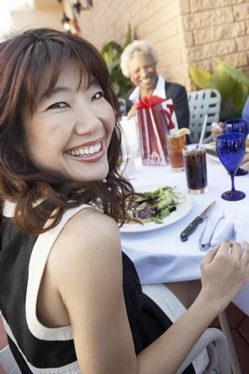 Smiling Woman Having Lunch