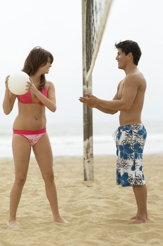 Young Woman Teasing Boyfriend on Beach