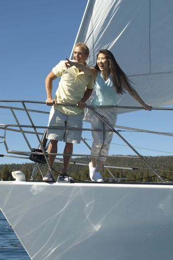 Couple Standing on Bow of Sailboat