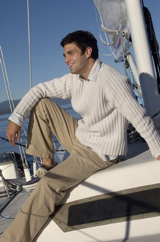 Man Sitting on Sailboat Deck