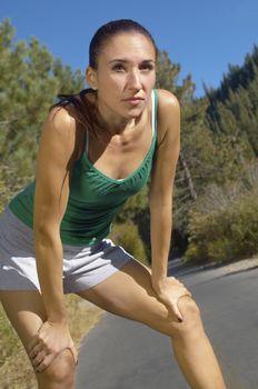 Woman Taking a Break During Her Jog