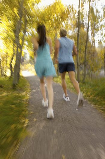 Couple Jogging on Wooded Path