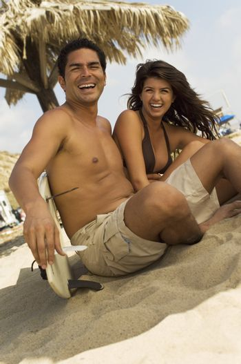 Surfing Couple Laughing in Shade