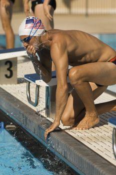 Swimmer Warming Up at Starting Blocks