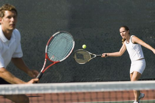 Mixed Doubles Partners in Tennis Match
