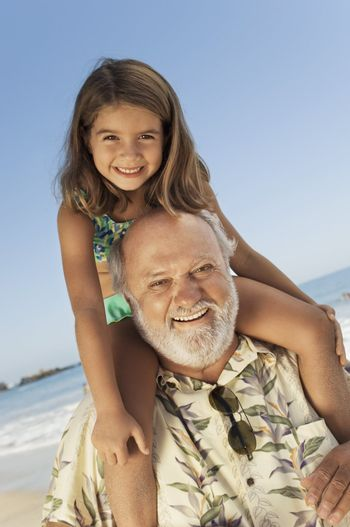 Girl Getting Piggy-Back Ride from Grandfather