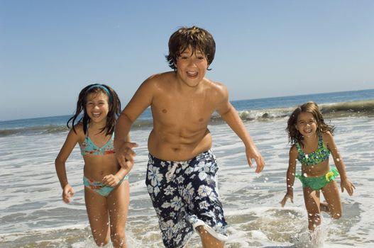 Kids Running Through Waves