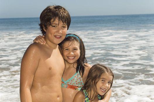 Kids Standing by the Ocean