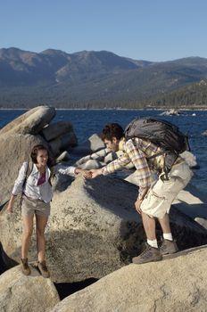 Couple Hiking on Boulders