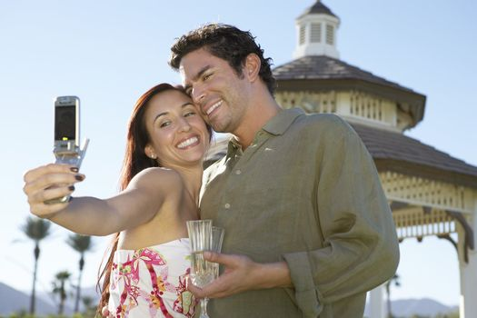 Couple Taking Photograph with Cell Phone