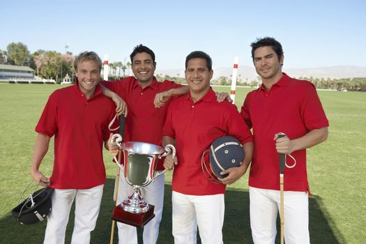 Polo Players with Trophy