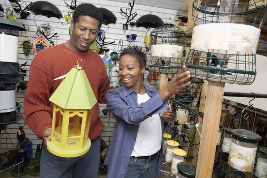 Couple Choosing a Birdhouse
