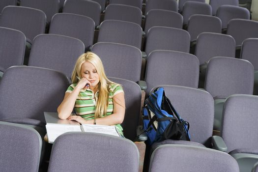 Sleepy Student Sitting in Lecture Hall