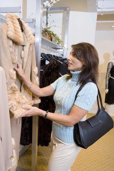 Woman Shopping for Fur Coat