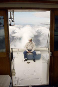 Boater at Back of Boat