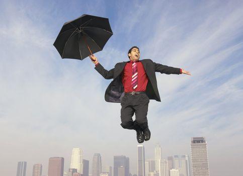 Falling Businessman with Umbrella