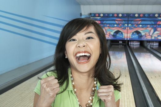 Young Woman Celebrating Bowling Score