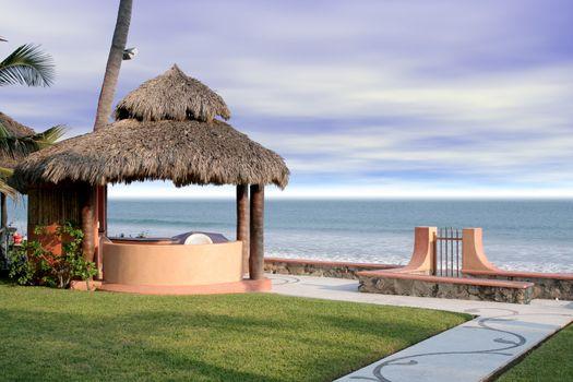Beautiful beach cabana overlooking ocean in grassy yard
