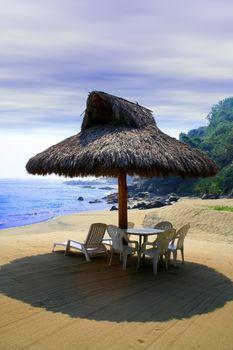 small beach cabana next to sea shore
