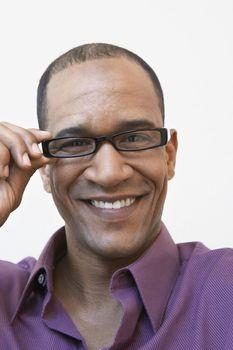 Man Adjusting His Eyeglasses