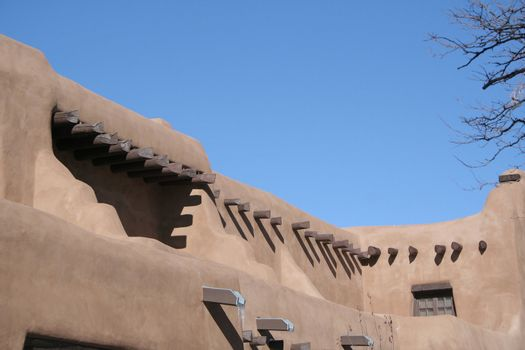 Adobe style building with wood beams
